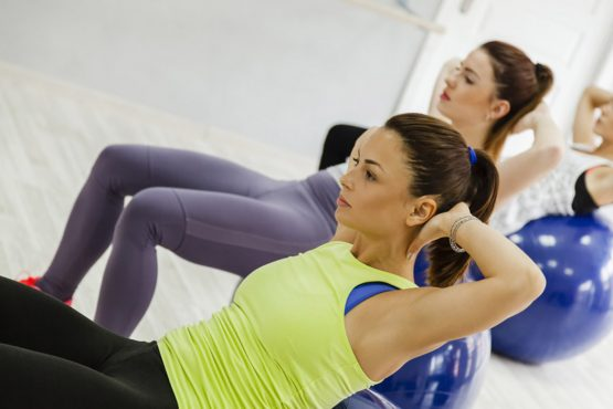 Group Of Females Doing Pilates