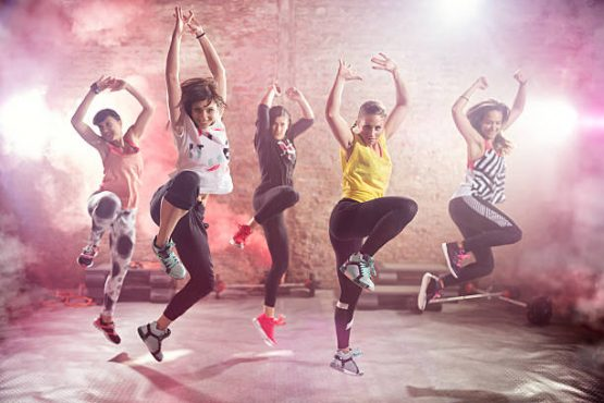 Group of fit young women dancing  and exercising